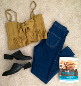 Mustard tie-front top, blue denim skinnies, black mules, and delicious cookie chips snack