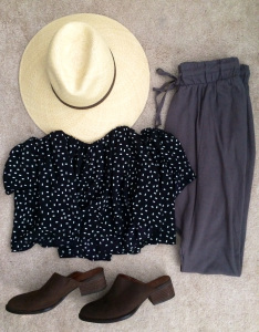 Panama straw hat, black and white flowy top, drawstring harem pants, and brown mules